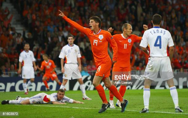Klaas Jan Huntelaar of the Netherlands jubilates after scoring the opening goal during the UEFA EURO 2008 Group C match between Netherlands and...