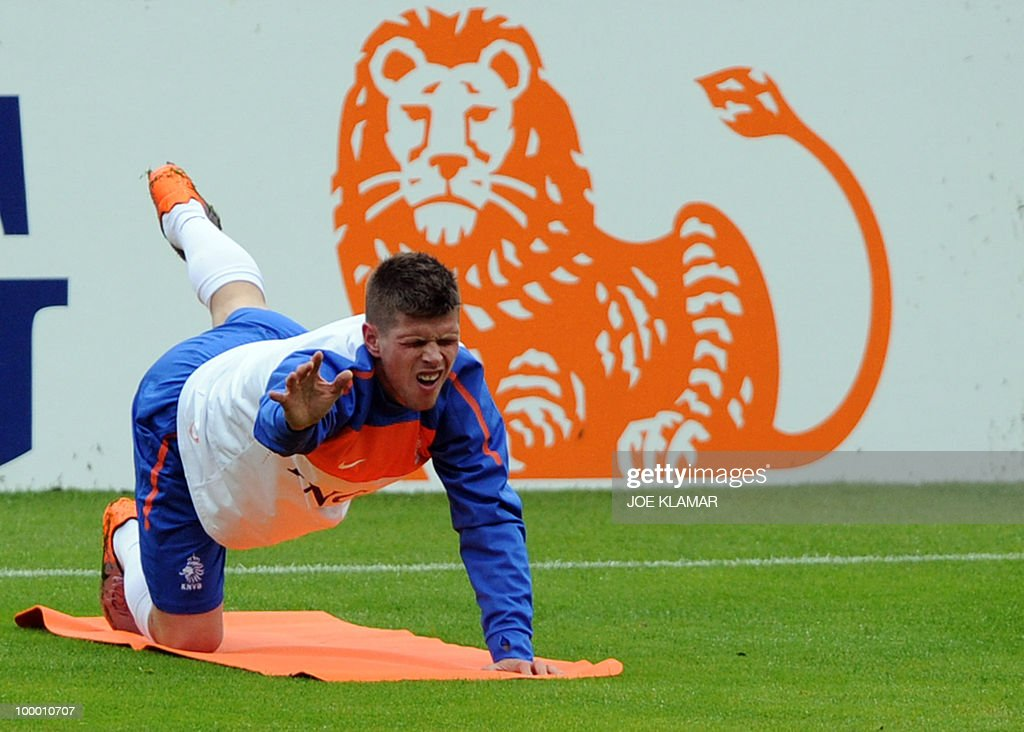 Klaas Jan Huntelaar stretches during the first Netherland's team's practice on the opening of their training camp in the Tyrolian village of Seefeld in Austria on 20 May 2010 in preparation for the 2010 FIFA World cup hosted by South Africa from June 11 to July 11.