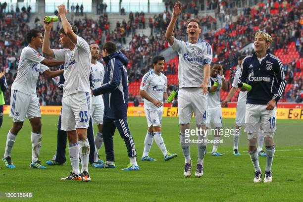KlaasJan Huntelaar Benedikt Hoewedes and Lewis Holtby of Schalke celebrate the 10 victory after the Bundesliga match between Bayer 04 Leverkusen and...