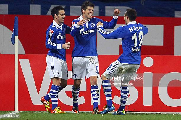 KlaasJan Huntelaar celebrates the fifth goal with José Manuel Jurado and Marco Hoeger during the Bundesliga match between FC Schalke 04 and SV Werder...