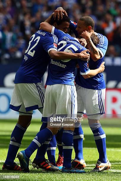 KlaasJan Huntelaar celebrates the first goal with Joel Matip and Jermaine Jones of Schalke during the Bundesliga match between FC Schalke 04 and...
