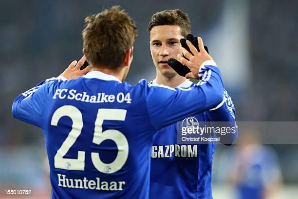 KlaasJan Huntelaar celebrates the third goal with Julian Draxler of Schalke during the DFB Cup second round match between FC Schalke 04 and SV...