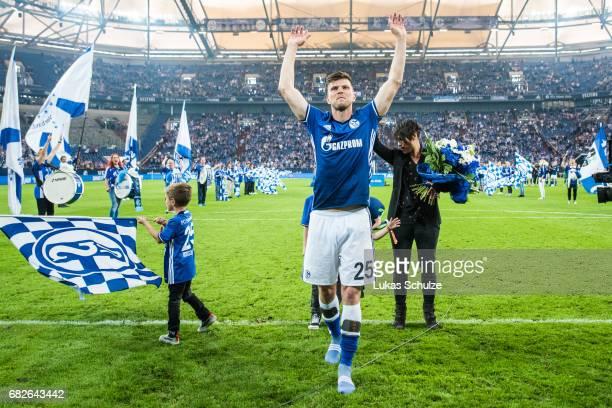Klaas-Jan Huntelaar celebrates with fans one of his last matches for Schalke 04 after the Bundesliga match between FC Schalke 04 and Hamburger SV at...