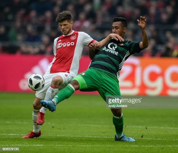 KlaasJan Huntelaar from AJAX is challenged by Joey Sleegers from Feynoord during the Eredivisie match between AJAX Amsterdam and Feyenoord on January...
