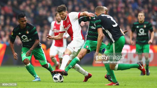 KlaasJan Huntelaar of Ajax battles with Renato Tapia and Karim El Ahmadi of Feyenoord during the Dutch Eredivisie match between Ajax Amsterdam and...