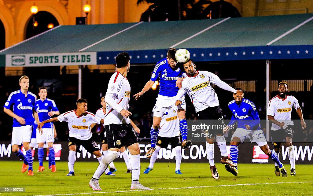 Klaas-Jan Huntelaar #25 of FC Schalke 04 and Maicon Santos #29 of the Fort Lauderdale Strikers go up for a header during the match at the ESPN Wide World of Sports Complex on January 10, 2016 in Kissimmee, Florida.