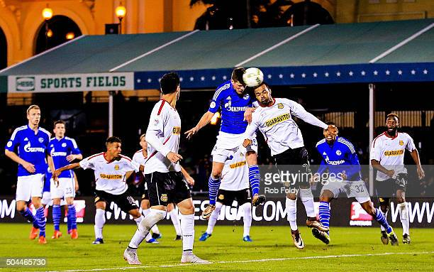 KlaasJan Huntelaar of FC Schalke 04 and Maicon Santos of the Fort Lauderdale Strikers go up for a header during the match at the ESPN Wide World of...