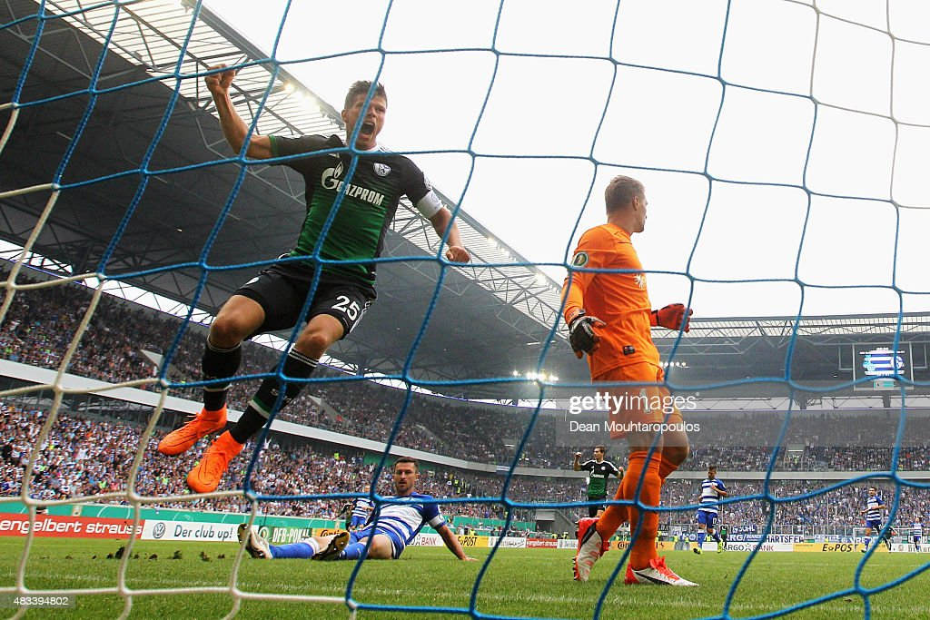 Klaas-Jan Huntelaar of FC Schalke 04 celebrates after he shoots and scores a goal in the opening minutes past Goalkeeper, Michael Ratajczak of MSV Duisburg during the DFB Cup match between MSV Duisburg and FC Schalke 04 held at Schauinsland-Reisen-Arena on August 8, 2015 in Duisburg, Germany.