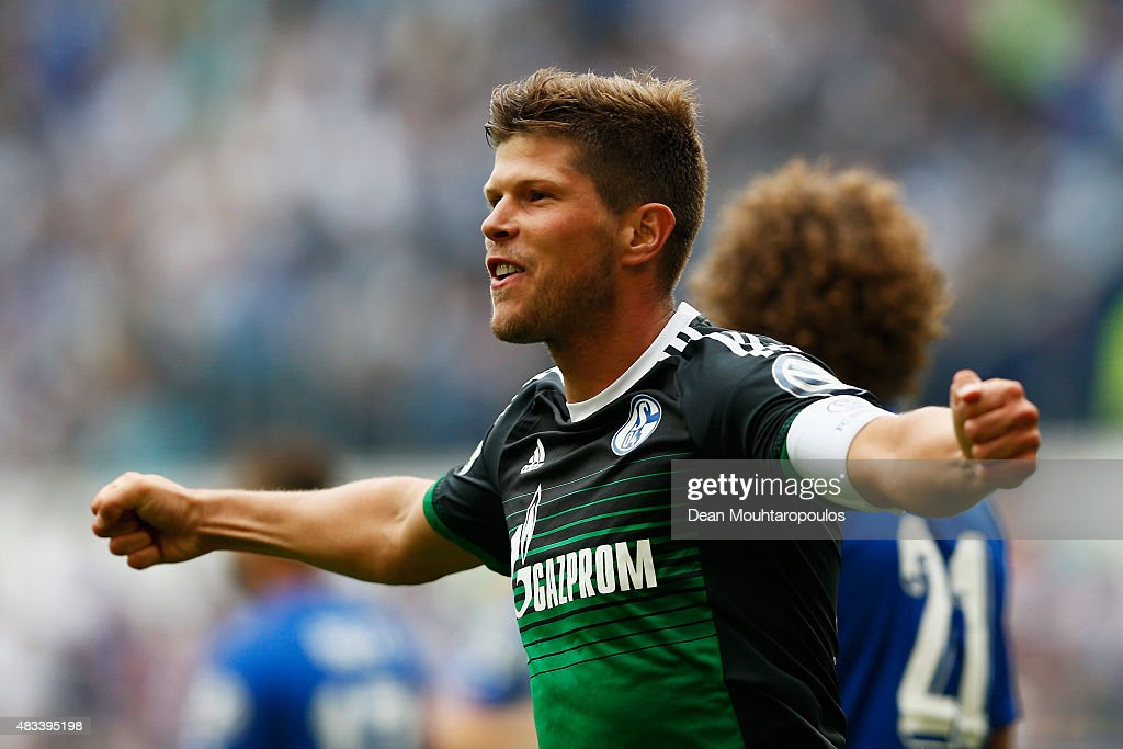 Klaas-Jan Huntelaar of FC Schalke 04 celebrates after he shoots and scores a goal in the opening minutes during the DFB Cup match between MSV Duisburg and FC Schalke 04 held at Schauinsland-Reisen-Arena on August 8, 2015 in Duisburg, Germany.