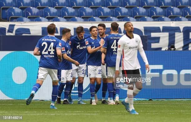 Klaas-Jan Huntelaar of FC Schalke 04 celebrates with team mates after scoring their side's first goal during the Bundesliga match between FC Schalke...