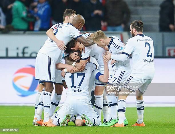 KlaasJan Huntelaar of FC Schalke 04 celebrates with teammate Jefferson Farfan after heading his team's second goal during the Bundesliga match...