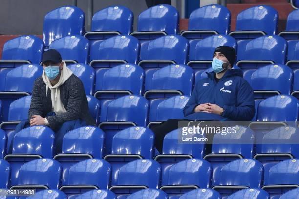 Klaas-Jan Huntelaar of FC Schalke 04 is seen in the stand wearing a face mask with team mate, Sead Kolasinac during the Bundesliga match between FC...