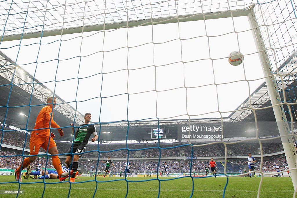 Klaas-Jan Huntelaar of FC Schalke 04 shoots and scores a goal in the opening minutes past Goalkeeper, Michael Ratajczak of MSV Duisburg during the DFB Cup match between MSV Duisburg and FC Schalke 04 held at Schauinsland-Reisen-Arena on August 8, 2015 in Duisburg, Germany.
