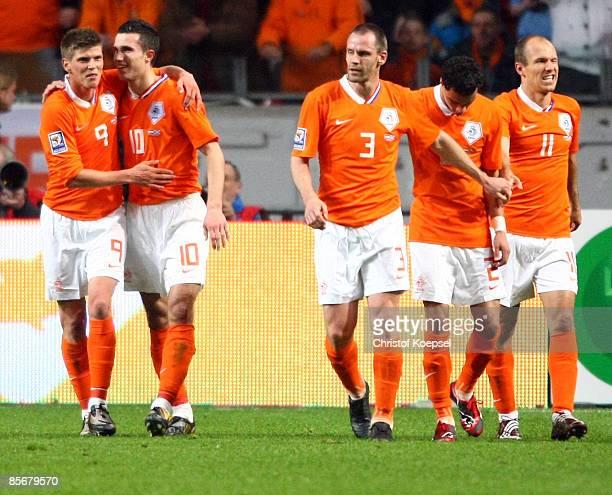 KlaasJan Huntelaar of Netherlands celebrates the second goal with Robin van Persie c during the FIFA 2010 World Cup qualifying match between...