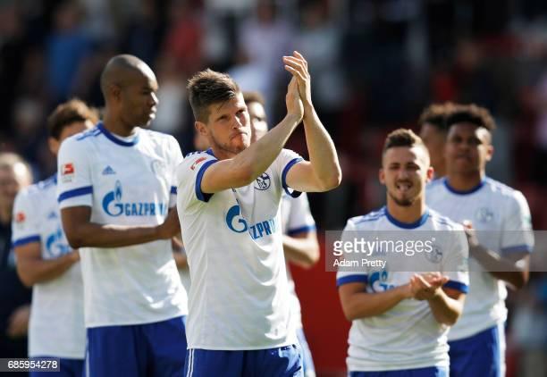 KlaasJan Huntelaar of Schalke 04 thanks the fans after the Bundesliga match between FC Ingolstadt 04 and FC Schalke 04 at Audi Sportpark on May 20...