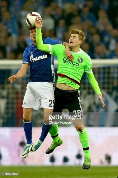 KlaasJan Huntelaar of Schalke and Matthijs de Ligt of Amsterdam go up for a header during the UEFA Europa League quarter final second leg match...