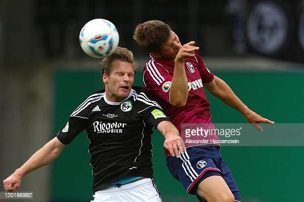 Klaas-Jan Huntelaar of Schalke battles for the ball with Alexander Volk of Teningen during the DFB Pokal first round match between FC Teningen and FC...