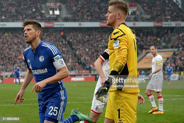 Klaas-Jan Huntelaar of Schalke celebrates after scoring the opening goal from a penalty as goalkeeper Timo Horn of Koeln looks dejected during the...