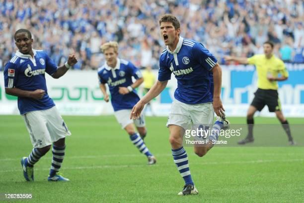 KlaasJan Huntelaar of Schalke celebrates during the Bundesliga match between FC Schalke 04 and SC Freiburg at Veltins Arena on September 24 2011 in...