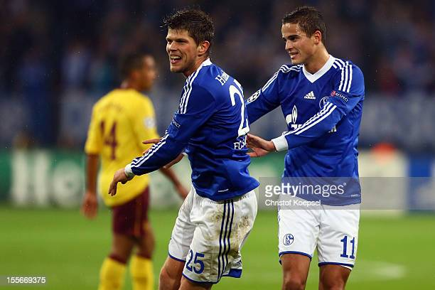 KlaasJan Huntelaar of Schalke celebrates the first goal with Ibrahim Affelay during the UEFA Champions League group B match between FC Schalke 04 and...