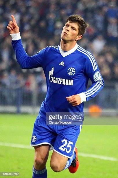 Klaas-Jan Huntelaar of Schalke celebrates the third goal during the DFB Cup second round match between FC Schalke 04 and SV Sandhausen at...