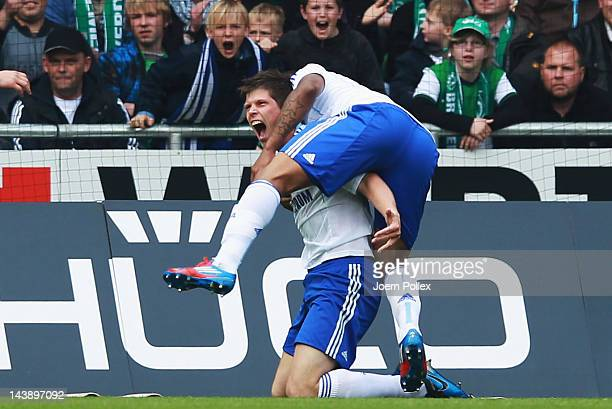 Klaas-Jan Huntelaar of Schalke celebrates with his team mate Jefferson Farfan after scoring his team's second goal during the Bundesliga match...
