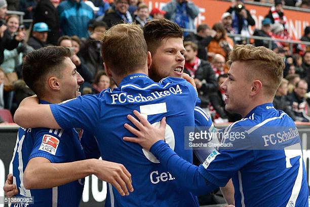KlaasJan Huntelaar of Schalke celebrates with team mates after scoring the opening goal from a penaltyd uring the Bundesliga match between 1 FC Koeln...