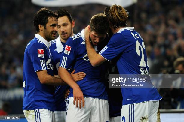 Klaas-Jan Huntelaar of Schalke celebrates with teammates Raul, Marco Hoeger, Jefferson Farfan and Christian Fuchs after scoring his team's second...