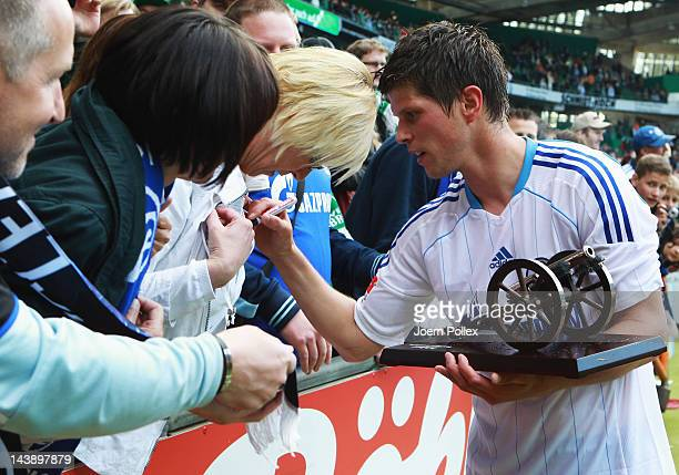 KlaasJan Huntelaar of Schalke gives autographs to fans after he received the cup for topscorer in season 2011/2012 of Kicker magazine after the...