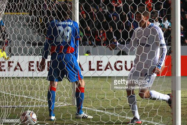 Klaas-Jan Huntelaar of Schalke scores the first team goal during the UEFA Europa League Round of 32 first leg match between FC Viktoria Plzen and...