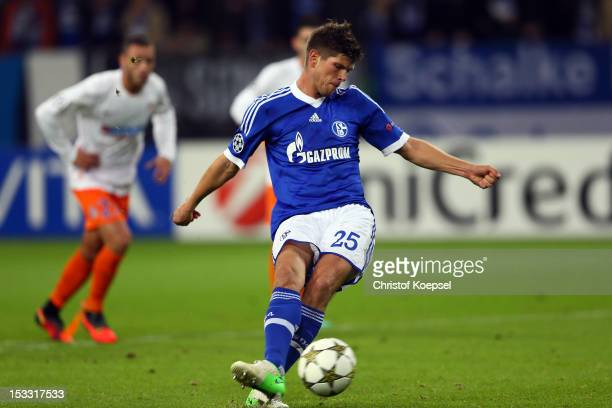 KlaasJan Huntelaar of Schalke scores the second goal by penalty during the UEFA Champions League group B match between FC Schalke 04 and Montpellier...
