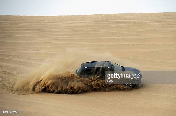Klaas-Jan Huntelaar of Schalke steers a VW Touareg during a trip to the desert outside Doha at the Schalke 04 training camp on January 7, 2013 in...