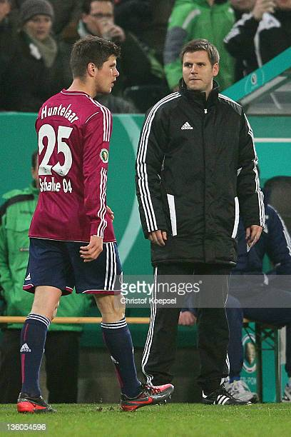 Klaas-Jan Huntelaar of Schalke walks off the pitch afdter getting a yellow-red card during the DFB Cup round of sixteen match between Borussia...