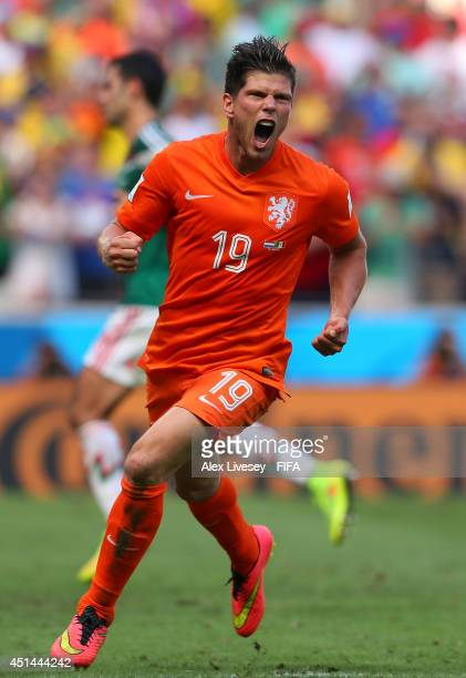 KlaasJan Huntelaar of the Netherlands celebrates scoring his team's second goal from the penalty spot during the 2014 FIFA World Cup Brazil Round of...