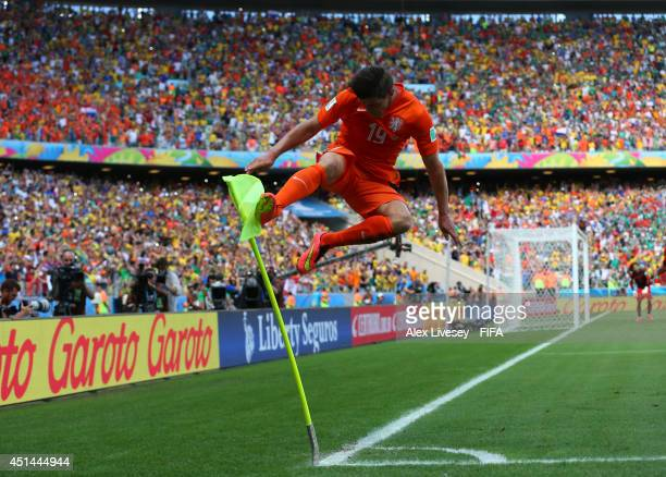 Klaas-Jan Huntelaar of the Netherlands celebrates scoring his team's second goal from the penalty spot during the 2014 FIFA World Cup Brazil Round of...