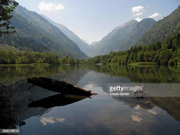 Klammsee (Lake Klamm) surrounded by mountains with glacier Kitzsteinhorn in summer