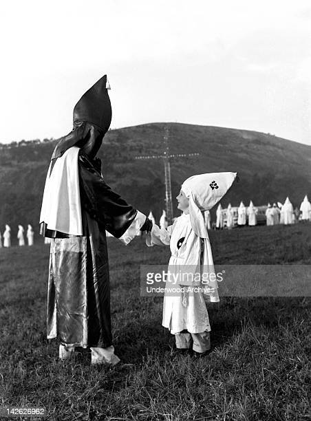 Klan tykes appear in regalia at the mass initiations into the Ku Klux Klan Stone Mountain Georgia July 23 1948