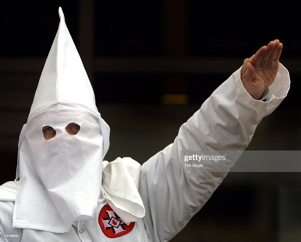 Ku klux klan stock photos and pictures getty images klansman raises his left arm during a white power chant at a ku klux biocorpaavc Images