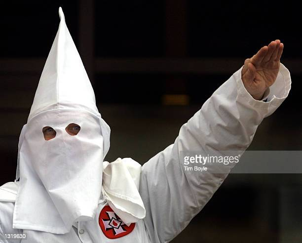 Klansman raises his left arm during a white power chant at a Ku Klux Klan rally December 16 2000 in Skokie IL A Wisconsin chapter of the Ku Klux Klan...