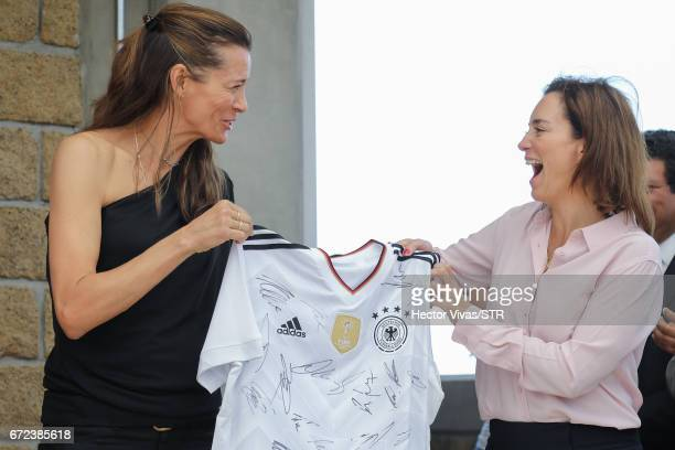 Klara Bierhoff and Laura Franco President of Laureles Foundation holds a signed Germany jersey during the visit and unveiling of plaque for the...