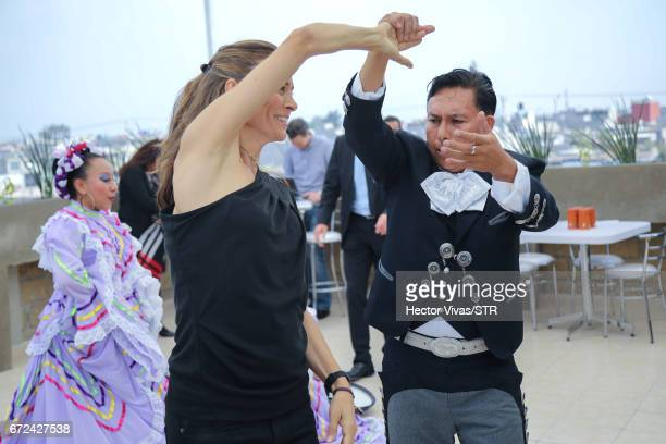 Klara Bierhoff dances with mexican folkloric dancers during the visit and unveiling of plaque for the economic support given by the DFB Egidius Braun...