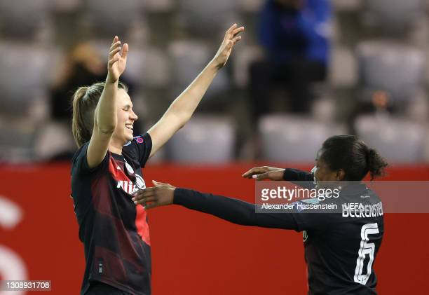 Klara Buehl of FC Bayern Munich celebrates with team mate Lineth Beerensteyn after scoring their side's second goal during the First Leg of the UEFA...
