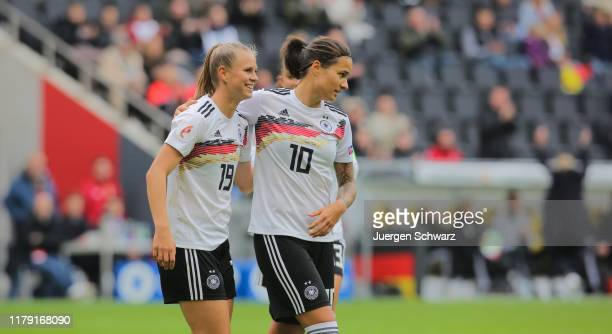 Klara Buehl of Germany and Dzsenifer Marozsan celebrate during the UEFA Women's European Championship 2021 qualifier match between Germany and...