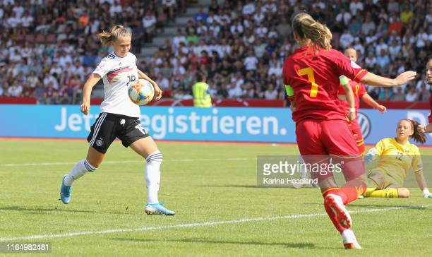 Klara Buehl of Germany scores the fourth goal Goalkeeper Ivana Cabarkapa of Montenegro without a chance during the Women's EM Qualification match...