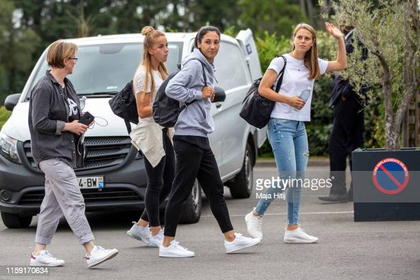 Klara Buehl , Sara Doorsoun and Giulia Gwinn of Germany leave to the bus as the Germany Women's National Team departs on June 30, 2019 in Rennes,...