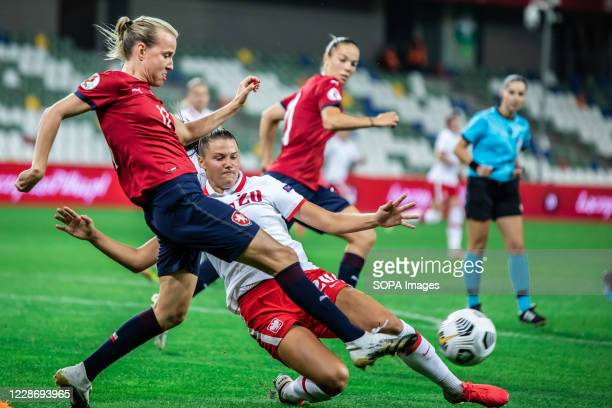 Klara Cahynova of Czech Republic and Malgorzata Grec of Poland are seen in action during the UEFA Women's EURO 2021 qualifying match between Poland...