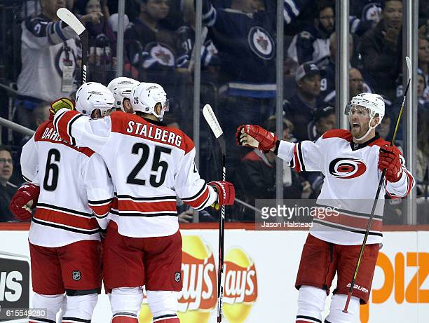 Klas Dahlbeck Viktor Stalberg Bryan Bickell and Jordan Staal the Carolina Hurricanes celebrate Staal's goal against the Winnipeg Jets during NHL...