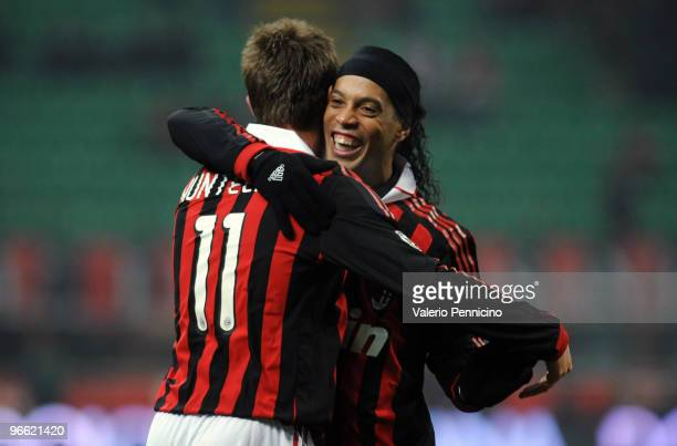 Klas Jan Huntelaar of AC Milan celebrates his second goal with Ronaldinho during to the Serie A match between AC Milan and Udinese Calcio at Stadio...
