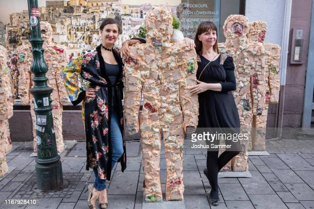 Klaudija Paunovic and Anna Zlotovskaya during Artist HA Schult presents his new sculptures 'Trash People' at the press conference of Go Matera Go by...