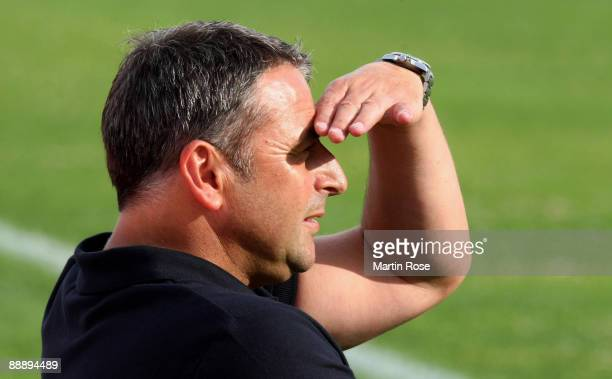 Klaus Allofs manager of Bremen attends the pre season friendly match between RotWeiss Essen and Werder Bremen at the Stadium Norderney on July 7 2009...